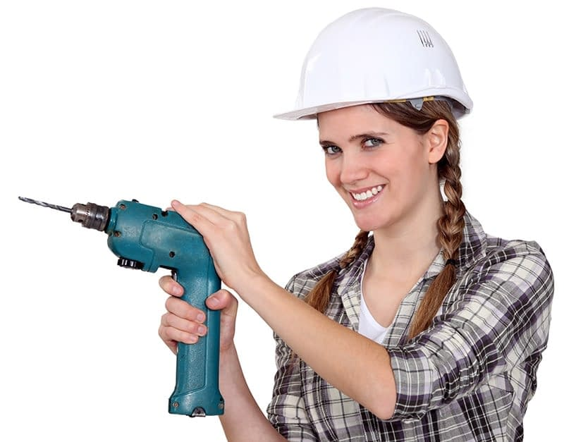 Woman with drill demonstrating the power of tools for success