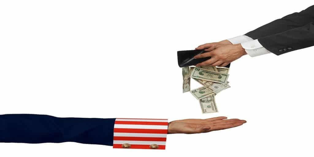 Avoid taxes in retirement. Uncle Sam represents the IRS. He has a hand outstretched to take money from your wallet.
